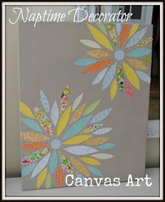 spray paint canvas, then mod podge scrapbook paper petals.