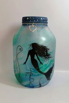 Hand painted mermaid Lantern, candle holder, light jar, night light, wedding centrepiece, MADE TO ORDER. by melOnDesign on Etsy https://www.etsy.com/listing/277057942/hand-painted-mermaid-lantern-candle