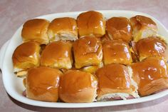 Hot Party Sandwiches: 1 pkg + 4 Hawaiian Dinner Rolls; 1 lb shaved ham & 1 lb thinly sliced Swiss cheese. Sauce: 1 stick butter; 1/4 C + 2 T brown sugar; 2 T yellow mustard & 2 T Worcestershire sauce. Preheat oven to 325 degrees. Melt sauce ingredients in sauce pan over low heat. While it is melting, slice rolls in half.  Line bottoms of rolls in buttered pans, bottom (brown) side down. Place a piece of ham/cheese on each.