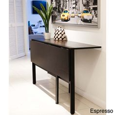 @Overstock.com - This space saving folding table is perfect for a small apartment in a city where room is limited. Open dining table up and enjoy a nice dinner with friends and family. Close it half way and use it as a console table or even a desktop. http://www.overstock.com/Home-Garden/Tokyo-Drop-Leaf-Rectangle-Dining-Table/7123645/product.html?CID=214117 $214.99