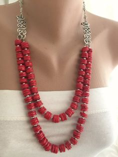 2 Strands Layered ,Red , Heishi Coral Necklace with Silver Plated Brass Embellishment. Beautiful combination of coral and silver embellishments. The length of the necklace is 19 inches and 3 inches adjustment chain.