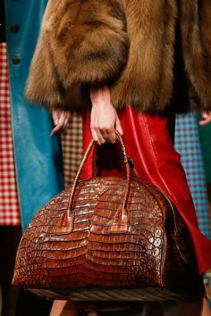One day I will be successful enough to own dozens of amazing bags such as this beauty!   Prada Fall 2013