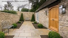 The elegant and beautifully appointed entrance to a large family home near Cirencester by Rixon Architects features our Raj Beige 60cm wide limestone flagstones in random lengths which perfectly compliment the Cotswold stone walls which surround the property. #ExternalLimestonePaving #LimestoneFlagstones #CotswoldStonePaving