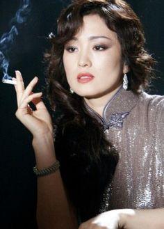 The talented Gong Li . Gong Li was born 31 December 1965 Gong Li, Women Smoking, Girl Smoking, What Are Skin Tags, Asian Woman, Asian Girl, Asian Ladies, Beautiful Women Over 40, Beautiful Chinese Women