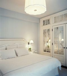 Is There Any Hope For A Windowless Room? - laurel home fabulous soft bedroom with pale blue gray walls by Christina Murphy and Meg Gabriele via Lonny - Adding mirrors and a mirrored transom as needed light and sparkle to a dark room.