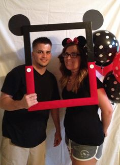 Mickey Mouse birthday party photobooth frame! To make you will need wood, black paint, red felt, white buttons and I'm not sure what kind of board it was to make the ears it wasn't a poster board it was a bit stiffer. Found it all at hobby lobby!
