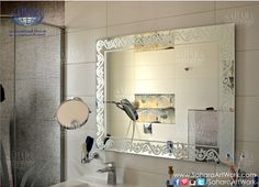 Silver bathroom mirror with sandblasted classic designed frame and backlights.