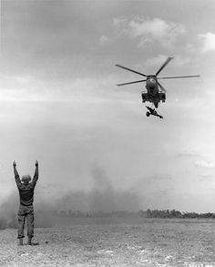 Arriving at a forward area, a U. Air Force helicopter carrying a howitzer is directed in for a landing, ca. February The artillery piece, which was in a rear area and was needed… North Vietnam, Vietnam War, American History, Landing, Carry On, Air Force, Fighter Jets, February, Aircraft