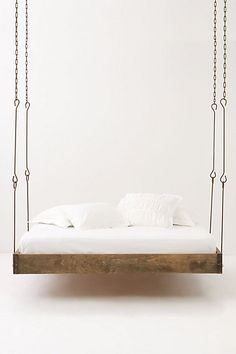 This hanging bed hovers from the ground just so, keeping you afloat as you drift peacefully off to dream