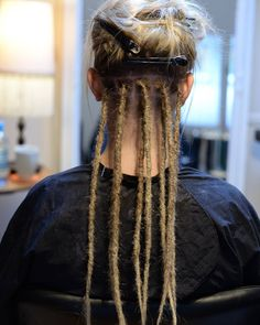 Here is a work in progress photo. On this girl I did dreads on her own hair and then extended her hair with human hairextensions. I always start with making sections of the hair in the size for the...
