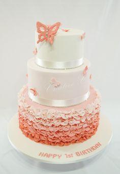 Peach ruffles and butterflies cake