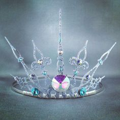 Made with beautiful light weight silver clock hands, this is your every day ice queen crown. The delicate hands are securely wire wrapped to a tiara