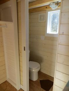 A peek at the bathroom and the closet (on the left) of the Home Run, a baseball themed tiny house! See more at brevardtinyhouse.com