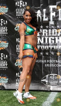 Running back Tiara Turley appears during Miami Caliente Media Day at FIU Stadium.  The Miami Caliente is one of ten teams in the Lingerie Football League. Miami, FL. 11/18/10.