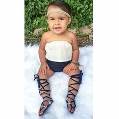 Our simple boho headbands are perfect for every day wear or dressing up an outfit. Available in the shop in tons of colors.  Made by Danica's Chic Bowtique.  Boho kid. Boho baby. Toddler style. Baby style. Kid fashion. Baby lace up sandals. Baby gladiator sandals.