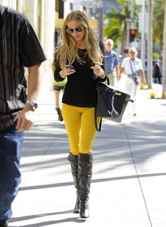Yellow jean, high boots, black long sleeved...this makes me want to buy yellow jeans!