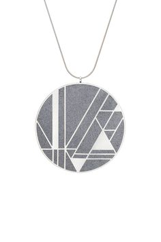 A modern statement necklace in concrete and stainless steel inspired by Frank Lloyd Wright's design motifs for the Imperial Hotel in Tokyo, Japan.  Available in Black or Dark Grey. $190 USD