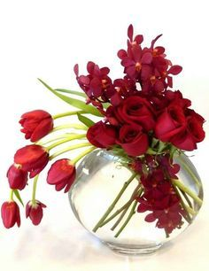 Stunning red contemporary style floral arrangement.: