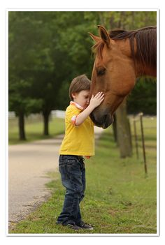 An autistic 5 year old and his connection with a horse.  How amazing is it that they both closed their eyes? SO SWEET!  ©Amanda Coley Photography