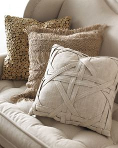 these pillows have so much fun texture! Love the strapping on the front one. I'm thinking quilt block!