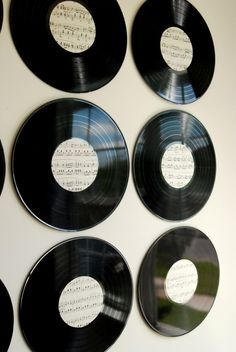 Make new art for your walls out of some old vinyl records and some vintage sheet music! This DIY will bring your vintage pieces to life on the wall.