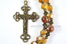 A rosary should be as precious and unique as a treasured piece of jewelry, its beauty meant to inspire meditative prayer and reflection on the life of Jesus. With that goal in mind, I have designed heirloom rosaries made with metal, crystal, glass and semi precious stone beads. The crucifix and centerpiece are recast antique pieces made of bronze or sterling silver to recreate the patina of a vintage rosary. I also like to base my design on a scripture verse or biblical concept. The…
