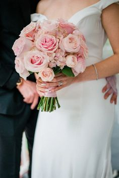 Bridal bouquet in soft pink with garden roses, spray roses, hydrangea.