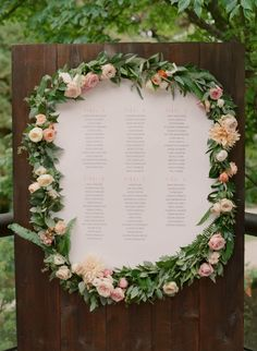 Gorgeous floral accented escort card wall: http://www.stylemepretty.com/canada-weddings/british-columbia/vancouver/2016/01/11/elegant-intimate-stanley-park-wedding/ | Photography: Gucio Photography: http://www.guciophotography.com/