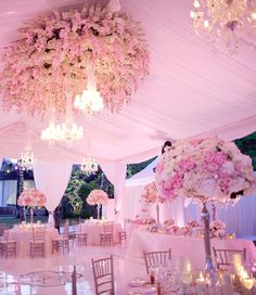 pretty soft pink wedding with hanging flowers and gorgeous chandeliers