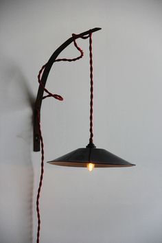 Great idea .....outdoor hook.....make a hanging lamp.
