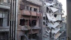 Damaged buildings in Juret al-Shayah in Homs, on July 3, 2012. (Reuters/Khaled Tellawi/Shaam News Network