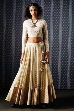 <p>Presenting a gorgeous outfit of a crop top, lehenga and dupatta in shades of gold. The pearl work on the dupatta stands out as the simple elegance of the crop top and lehenga lend sophistication to your look.</p><p><strong>COMPOSITION: </strong></p><p><strong></strong>Crop top and Lehenga-Net Brocade</p><p>Dupatta-Net</p><p><strong>DISCLAIMER: </strong> We require 3-6 weeks for the dispatch, as the product is customized.</p>
