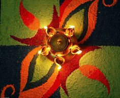 Diwali tip: If you plan to place a few diyas at the threshold of your home, instead of just placing one at each corner, you could arrange the diyas in a petal or flower pattern and do a rangoli around them, creating a lovely design all on your very own.