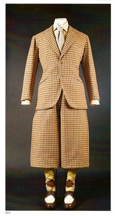 Pecan brown and beige wool Shepherd's check suit, 1934. Jacket by Scholte of London, trousers/plus-fours by Forster & Sons. Via 42ndblackwatch.com/.