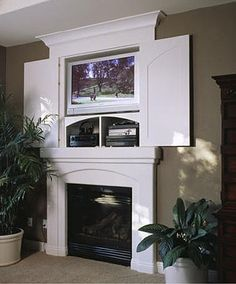 Above fireplace tv hideaway-good idea instead of armoire. I wonder if I can cut into my wall to get deep enough for my DVD player??