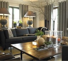 *Living Room - Love the earthy feel and color! Square and round contrast
