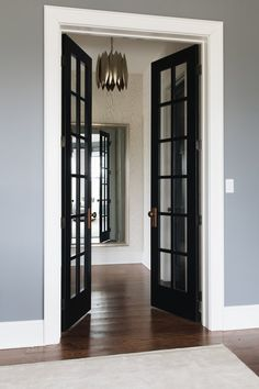 Inverway — jean stoffer design JSD Jean Stoffer Design- Black french doors and white skirting board and moulding around Black French Doors, French Doors Patio, Black Door, Dark Doors, White Doors, Blue Painted Walls, Blue Walls, Grey Walls White Trim, Black Interior Doors