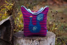 Shoulder bag from reclaimed sweaters with rooster applique and hand embroidery.