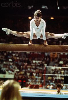 Nadia Comaneci Making Difficult Balance Beam Stretch