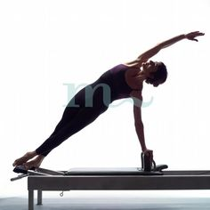 The most perfect Snake Twist I have ever seen. Dorothee on the reformer.