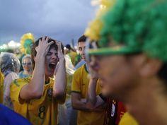 live telecast inside the FIFA Fan Fest area on Copacabana beach in Rio de Janeiro, Brazil, Tuesday, July 8, 2014