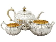 JOHN BRIDGE, LONDON (worked from c.1810-c.1850) Antique George IV Sterling Silver Three Piece Tea Service with Matching Teapot Stand  1823 London