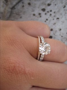 Very similar to my ring! I've been planning to get a matching wedding band, but I really like the contrast of a gold/rose gold one with it...