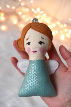 www.myknitandstitch.com Add this sweet little angel to your tree today! Her copper hair and wings are 100% wool felt and her sweet little face is hand painted. Watch as the light catches and shines on her metallic dress.