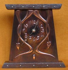hand crafted in copper ,pewter, wood and gemstones a range of clocks, mirrors and candlesconces from traditional celtic and Arts and Crafts styles to contemporary - absrtact.