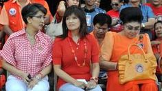 Imelda Marcos (R) and her two daughters, Imee and Irene