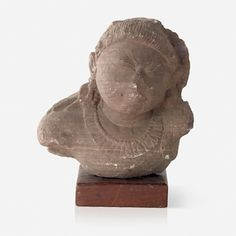 A RED SANDSTONE BUST OF A WOMAN, Central India or Rajasthan, 11/12th Century CE, Live Auction, Mumbai, December 17, 2014