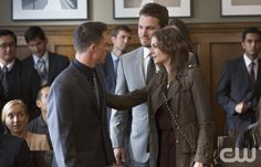 """Arrow -- """"State v. Queen"""" -- Image AR207b_0060bc -- Pictured (L-R): Colton Haynes as Roy Harper, Stephen Amell as Oliver Queen and Willa Holland as Thea Queen -- Photo: Jack Rowand/The CW -- � 2013 The CW Network, LLC. All Rights Reservedpn"""