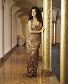 Shania Twain in a gold dress