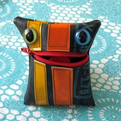 Love this guy. Change purse monster made from an old bike tire